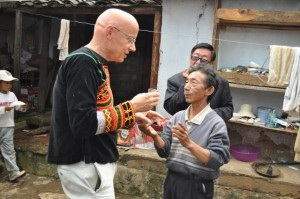 He Ying's grandfather, Hxisse Vuga, shares a toast with Steve at the Yangjuan School celebration in 2010.